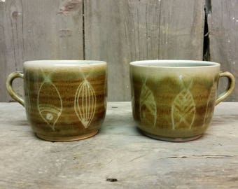Pair signed GALUCCI FISH studio pottery mugs