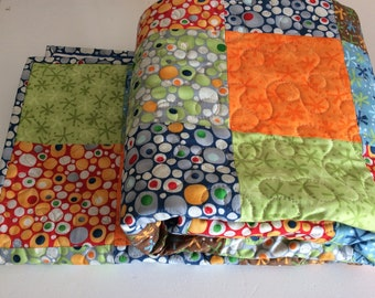 Patchwork toddler/baby quilt. Bright and cheerful colours.