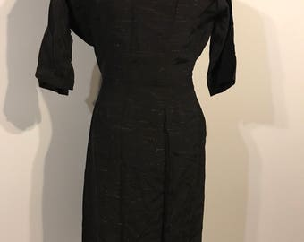 Stunning 1950s black wiggle dress