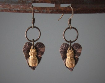 Aubrey Earrings: tiny golden brass owls over antique brass leaves dangle earrings are the perfect pair for every nature lover!