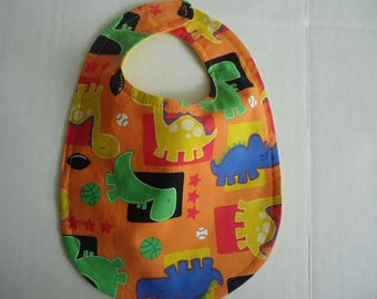 Dinosaur Bib.  Primary colored dinosaurs on an orange background backed in bright yellow flannelette..Ready to Ship