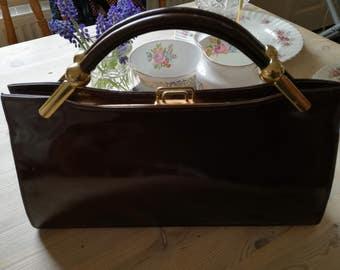 Vintage patent handbag with gold clasp
