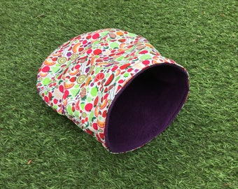 Cosy cave / cuddle sack for guinea pigs. Fruits pattern polycotton, water resistant interlining and aubergine fleece.