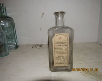 1890's AT Marsh Providence, RI  6 1/8 inch tall  Clear Vaniila food extract  bottle with paper label
