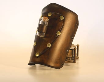 basic steampunk leather bracer with patch and vial , made to order