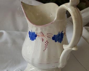 Pretty Victorian Staffordshire lustreware cream jug/pitcher. White with pink lustre and cornflower blue decoration