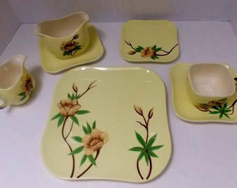 "square yellow dishes with green and brown accents Four place setting Weil Ware California pottery  ""Rose"" pattern  hand decorated"