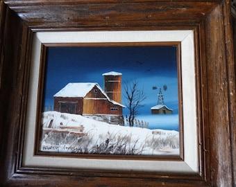Original oil winter barn landscape signed by Everett Woodson framed vivid blue sky and pure white snow