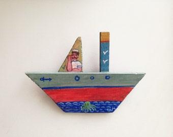 Sailor on wooden boat, folk art shabby boat of reclaimed wood, salvaged, old wood folk boat with Greek sailor painted, Greek folk art