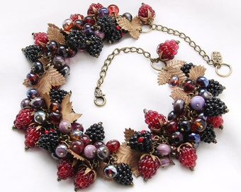 Glass lampwork necklace with a lot of berries and bronze leaves. Deep red and black color.