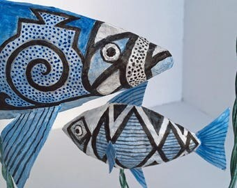 Large paper mache fish sculpture with southwestern design.