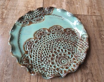 Handmade round pottery plate green with brown