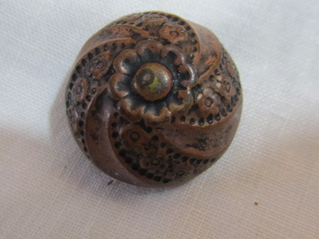 Carved dome button faux wood floral