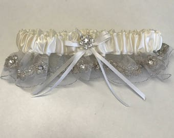 Rhinestone floral and ivory garter