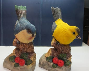 Two Vintage Bird Figurines Sitting On Tree Stumps Looking For Food