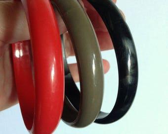 trio of plastic bangles red khaki green and black retro feel