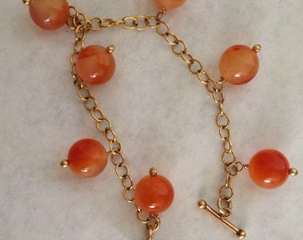 8 in 14k gold fill bracelet with 12mm round carnelian beads