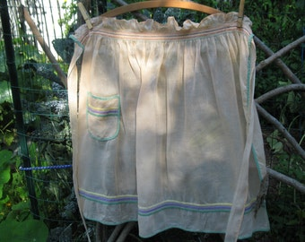Peach organza apron with ruching at waist and colored cotton trim