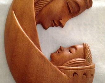 Serene Wood Carving of Mother and Child