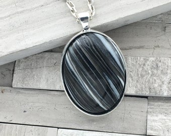 Black and white polymer clay oval pendant