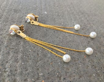 The earrings are made with long tassels