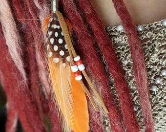 Orange dread feather, dreadlock feather, dread jewelry, feather on bead, Brown suede tassels, Black and white spotted guinea fowl feather