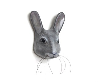 Only one Paper mache grey rabbit with the structure, eye catcher