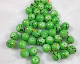 Festive Green Mottled 10mm Round Glass Beads