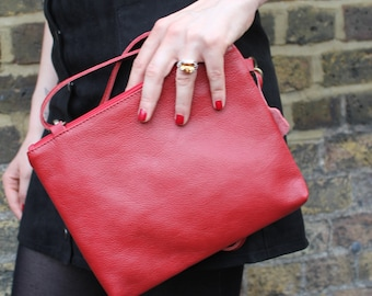 Sleeve bright red Leather cross body and Clutch bag