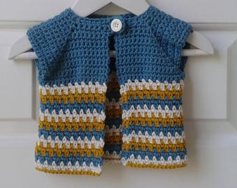 Newborn baby swing cardigan, in blue, cream and mustard. 100% cotton.
