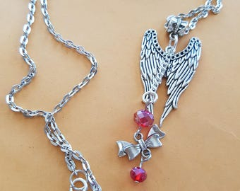 Angel wings & bows together with crystals in this cute necklace