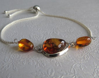 Baltic amber and sterling silver bracelet, with adjustable sliding clasp.