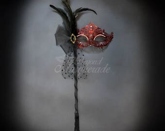 Red Goddess Filigree Metal Masquerade Mask with Handheld Stick - Soft Feather Adornments