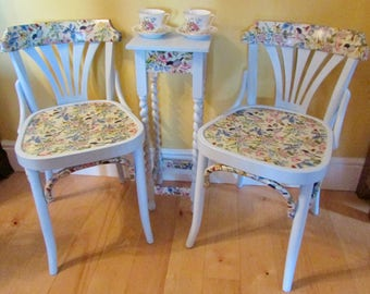 A pair of bentwood chairs with a barley twist table.