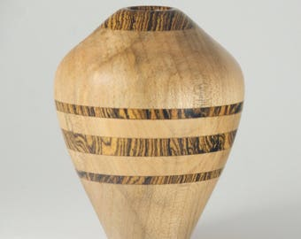 Hollow vase form turned from Figured Maple, with Mexican Rosewood (Bocote) striping