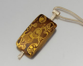 Mokume Gane Pendant - abstract sail shape in brass, sterling silver and copper