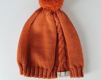 High quality, soft merino wool beanie with pom pom, nice ginger orange colour