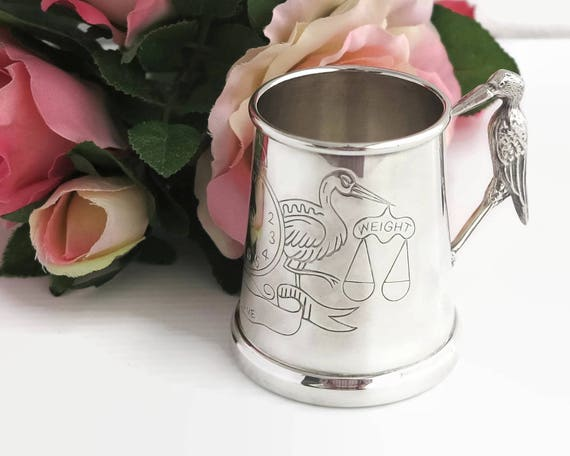 Silver plated baby's birth mug with stork handle and design on side for birth details, Whitehill, England