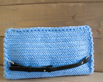 Ready! SKU blue clutch with leather handles.
