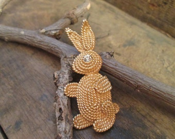 vintage gold tone napier coil rabbit with clear rhinestone brooch
