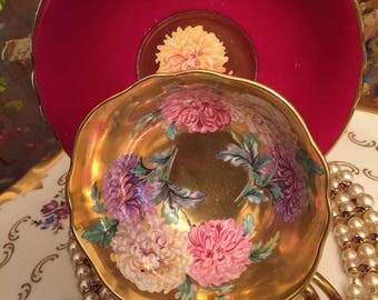 Paragon red Tea cup and saucer.