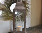 Dragonflies...just in time for spring!  Tall, metal hurricane lantern sprinkled with hand etched dragonflies.