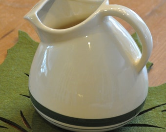Attractive vintage ceramic pitcher with green stripes. Made in Roseville, Ohio.