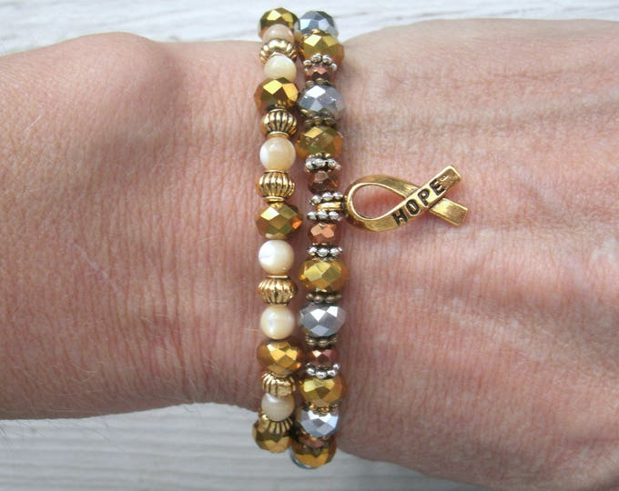 Awareness bracelets, gold ribbon awareness, stretch bracelets, hope, gold ribbon charm, agate, MOP & crystal, silver, copper, gold, bronze