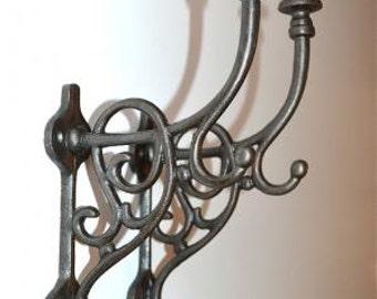 A pair of large Art Nouveau style triple cast iron coat hooks AL43