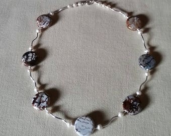 Elegant necklace made with sterling silver, agate beads and fresh water pearls.