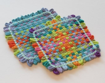 Two woven potholders or two extra large coasters, blue, purple, green, orange, pink, and whimsical kitchen decor, all cotton, eco-friendly