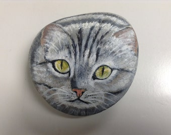 "Grey striped cat painting on sea rock. Size 5"" x 5"" x 1""     18.00"