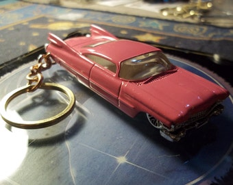 custom made keychain 1959 cadillac coupe,gloss hot pink w/chrome grill-tail lights-bumpers and mags/repaint-mint