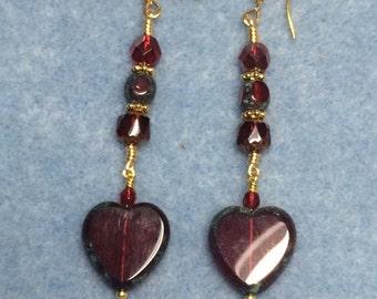 Dark red Czech glass heart bead dangle earrings adorned with dark red Czech glass beads.